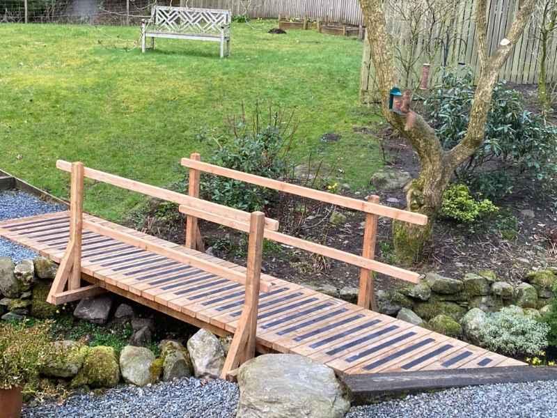 Anti Slip Decking Strips on Garden Bridge Feeding Squirrel