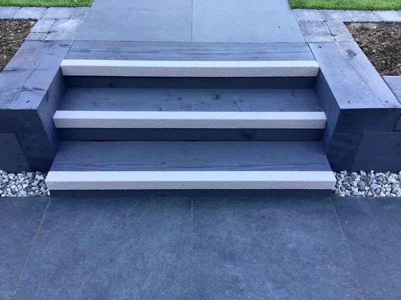 White anti slip stair nosing on timber steps