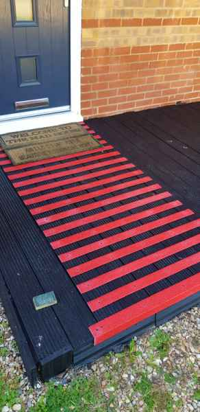 Red Non Slip Strips used on black decking