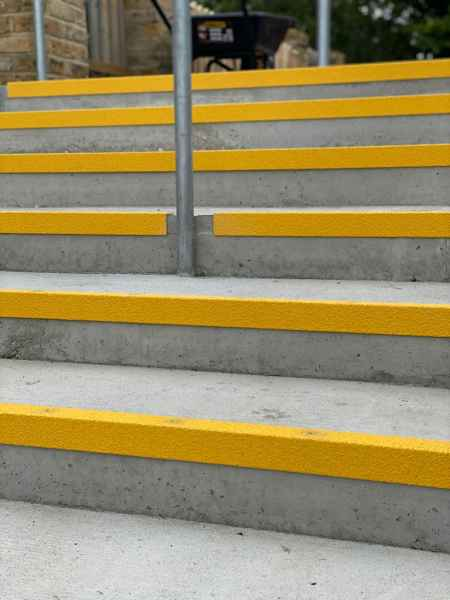 Anti slip yellow nosing on concrete stair