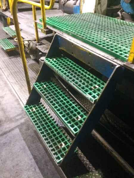 Green GRP Grating in workshop around lathes