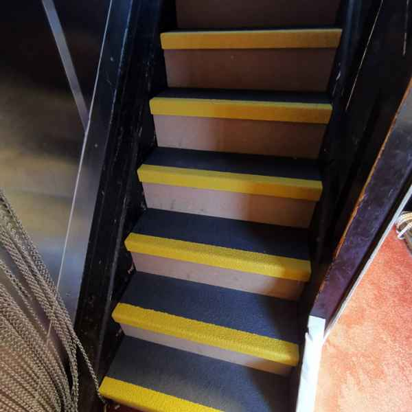Black and yellow GRP stair tread covers