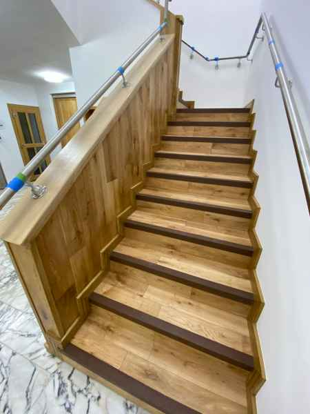 Brown stair nosing internal wooden office staircase