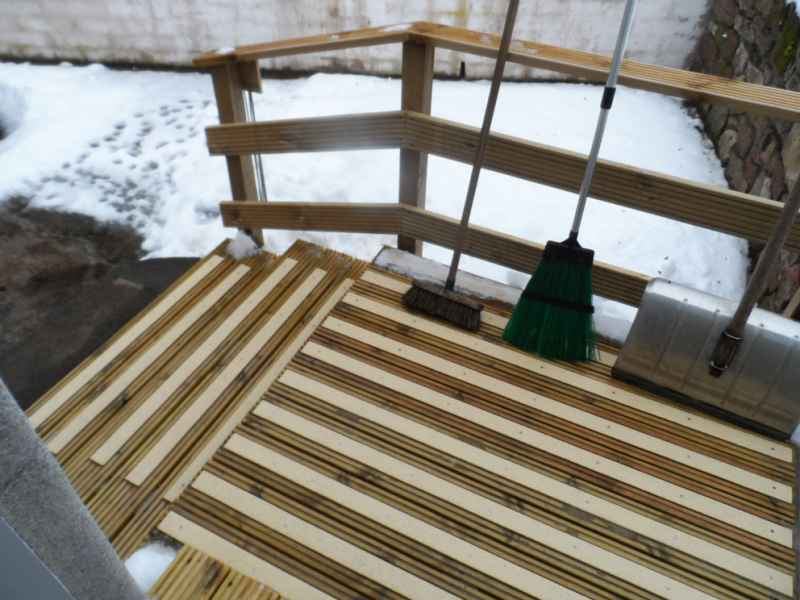Buff decking strips on snow covered decking ramp steps