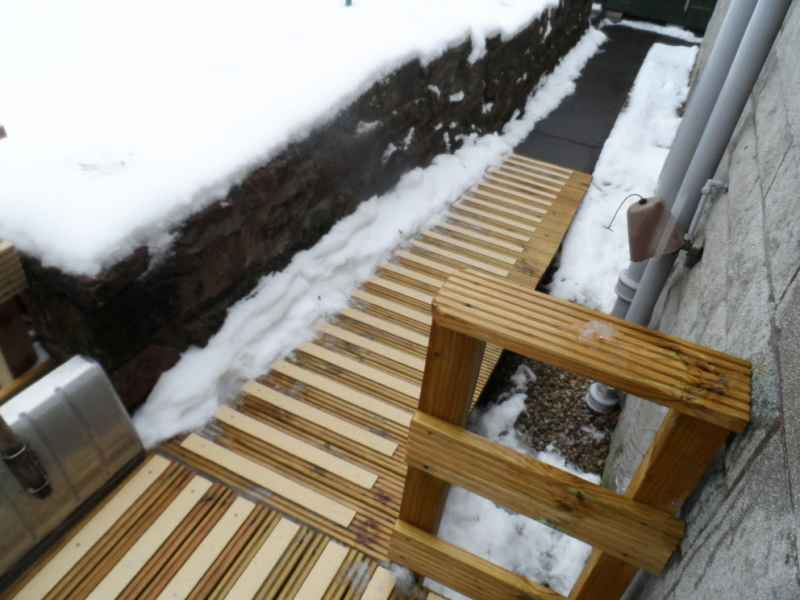 Buff GRP decking strips on snow covered decking ramp steps