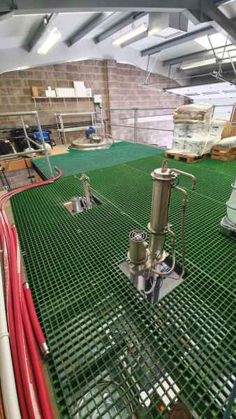 Green GRP grating in Exmoor Distiller mezzanine tank
