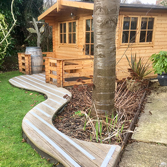 Garden Summer House decking strips installation.