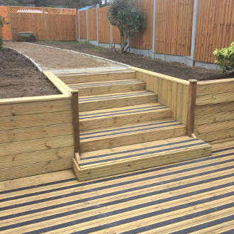 Patio decks and steps with black non-slip decking strips.