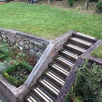 Garden areas with steep timber sleeper step areas.