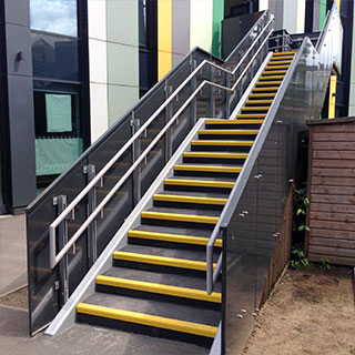 Anti-slip treads applied to stairs and landing areas.