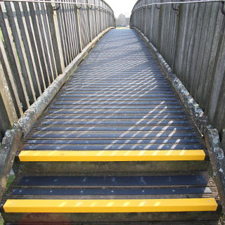 Decking strips fitted to the timber footbridge path.