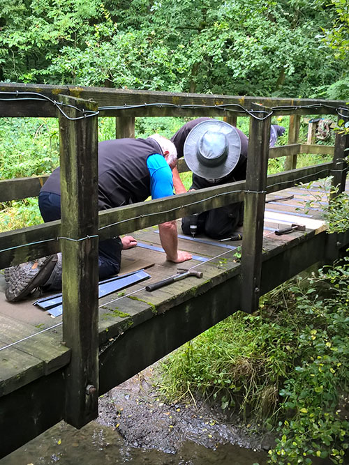 Preparing wooden treads on bridges and installing non-slip strips at the Harrington Nature Reserve.