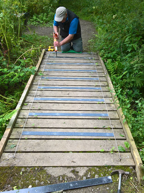 Replacing chicken wire with non-slip decking strips for the wooden footbridges throughout the Nature Reserve.