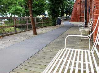 Gritted flat sheets create safe pathways.