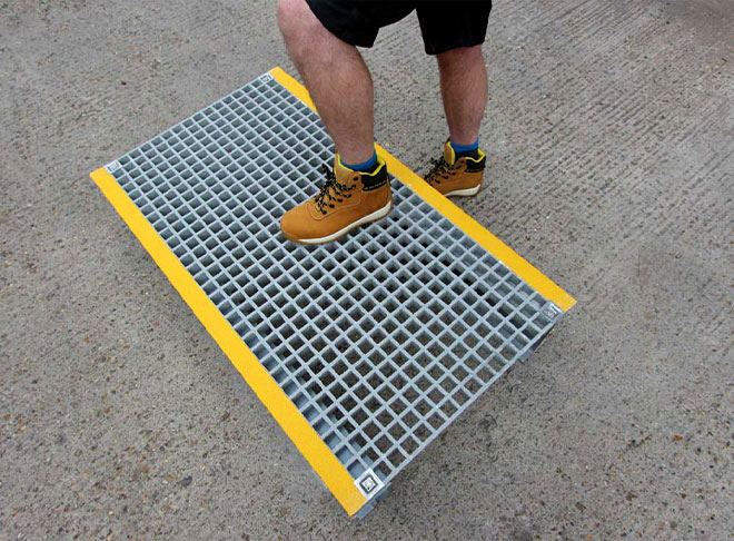 GRP grating platform for pipes, cables and trip hazards.