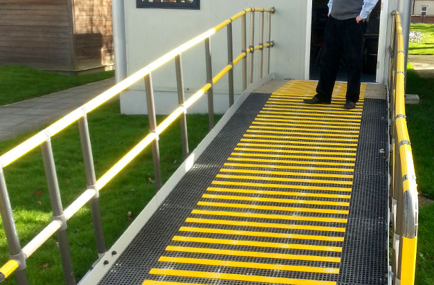High visibility yellow anti slip decking strips for wheelchair access.