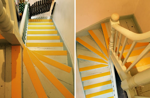 Beautiful entrance steps with yellow, high visability decking strips.