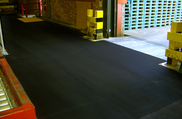 Anti-slip floor sheets commercial loading bay area installation.