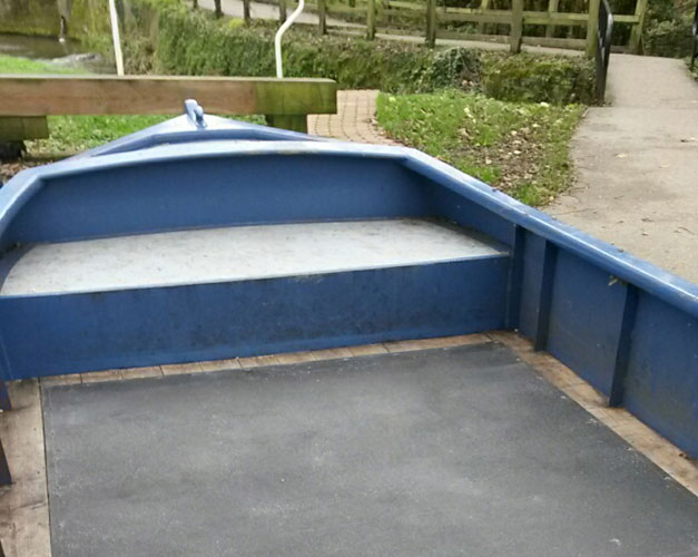 Slippery boat deck installation with non slip floor sheets.