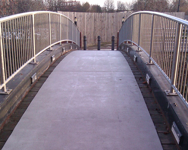 Anti-slip sheets create safer areas on a slippery timber bridge surface.