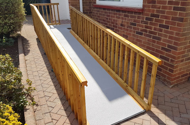 Non slip floor sheets improve safety on doorway access ramps.