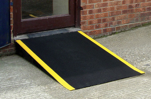 Floor sheets provide a non-slip area for a door threshold ramp.