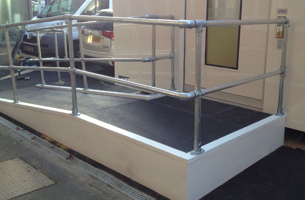 Non slip floor sheets wheelchair access ramps installation by facilities management.