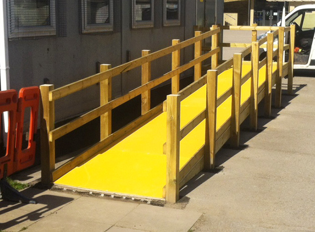 Non slip floor sheets improve safety on slippery wooden access ramps.