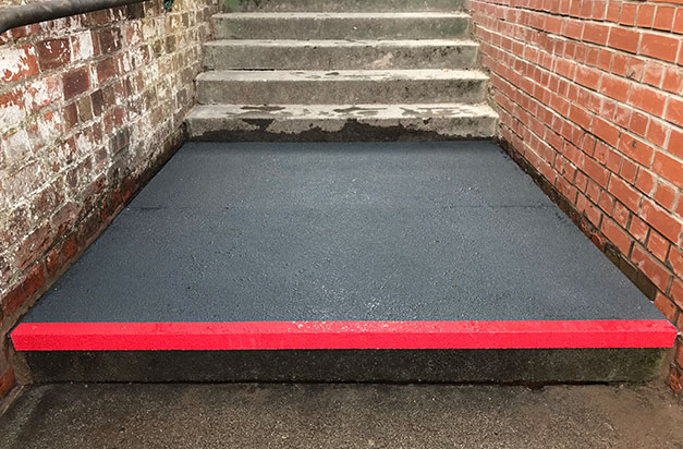Floor sheets cut-to-size and installed to large step landing areas, with stair nosing edging.