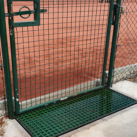 """GRP grid was cut-to-size to fit a plastic tray and then filled with water. Used as water batch to remove sand from players shoes after exiting tennis clay courts."" H Thuillier."