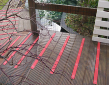 Non-slip decking strips bright colour garden design.