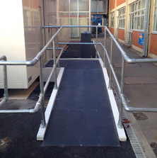 Non-slip floor sheets public access ramp.
