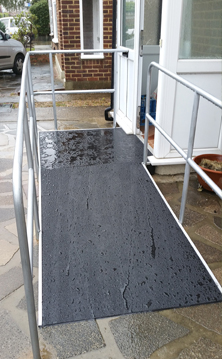 Non-slip floor sheets wheelchair access ramp.